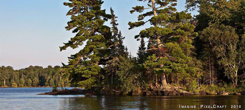 Island in Voyageurs National Park on Lake Kabetogama Minnesota. Voyager National Park is in the Border Lakes region of northern Minnesota and northwestern Ontario. This forested, lake-filled landscape covers 5.1 million acres surrounding Quetico Provincial Park, Voyageurs National Park and the Boundary Waters Canoe Area Wilderness. This region is part of the Superior National Forest in northeastern Minnesota