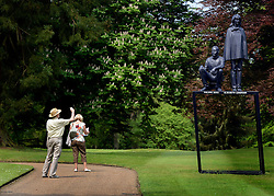 © Licensed to London News Pictures. 24/05/2012. Waddesdon, UK. A man photographs a sculpture. People enjoy the warm weather amongst an exhibition of contemporary sculpture at Waddesdon Manor, Buckinghamshire, today 24th May 2012. The exhibition is being held by Christie's as part of a private sale. Photo credit : Stephen Simpson/LNP
