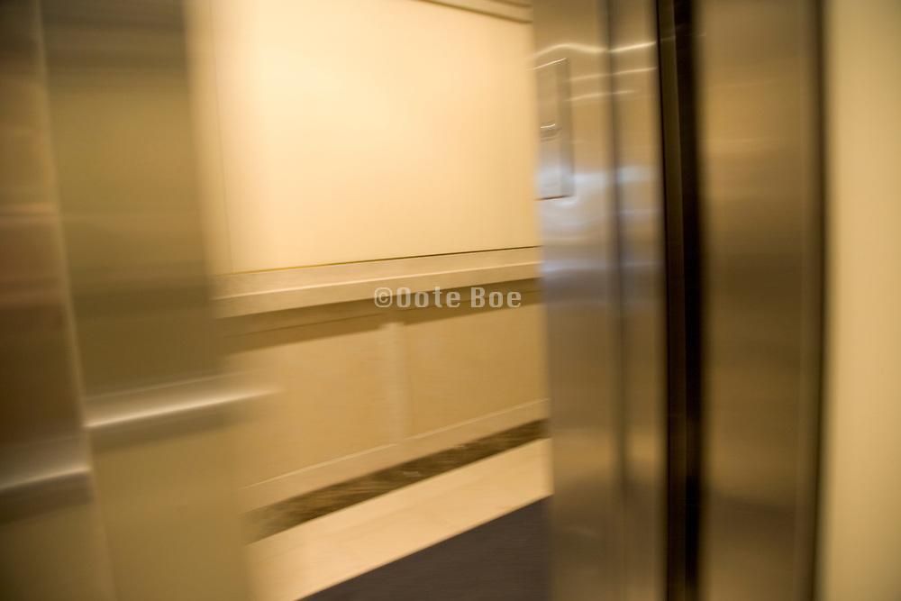 an opening elevator door in an office building in New York City