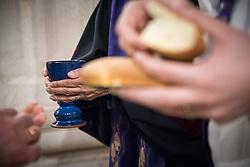 1 March 2020, Bethlehem: Bread and wine is distributed during Sunday service in the Evangelical Lutheran Christmas Church in Bethlehem.
