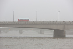 © Licensed to London News Pictures. 11/05/2016. LONDON, UK.  A bus and early morning commuters cross London Bridge during foggy and wet weather this morning.  Photo credit: Vickie Flores/LNP