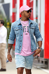 Mercedes Lewis Hamilton arrives in the paddock during the paddock day of the 2018 British Grand Prix at Silverstone Circuit, Towcester.