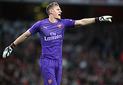 """Arsenal goalkeeper Bernd Leno gestures during the Carabao Cup, Third Round match at the Emirates Stadium, London. PRESS ASSOCIATION Photo. Picture date: Wednesday September 26, 2018. See PA story SOCCER Arsenal. Photo credit should read: Nick Potts/PA Wire. RESTRICTIONS: EDITORIAL USE ONLY No use with unauthorised audio, video, data, fixture lists, club/league logos or """"live"""" services. Online in-match use limited to 120 images, no video emulation. No use in betting, games or single club/league/player publications."""