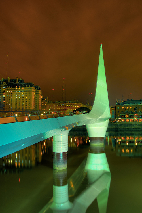 """Bridge """"La Mujer"""" in Puerto Madero, Buenos Aires. The Bridge was designed by Santiago Calatrava and its a Landmark on this tourist destination in Buenos Aires."""