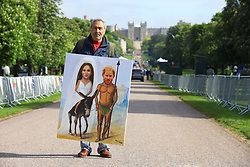 © Licensed to London News Pictures. 18/05/2018. London, UK. Artist Kaya Mar on the Long Walk with a painting of Prince Harry and Meghan Markle. Prince Harry and Meghan Markle are to be married in Windsor tomorrow, Saturday 19 May 2018. Photo credit: Rob Pinney/LNP