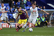Tranmere Rovers' Ash Taylor (r) and Notts County's Ronan Murray battle for the ball. Skybet football league one match, Tranmere Rovers v Notts county at Prenton Park in Birkenhead, England on Saturday 15th March 2014.<br /> pic by Chris Stading, Andrew Orchard sports photography.