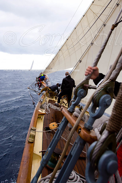 Crew onboard Mariette dropping the jib, racing at Regates Royales