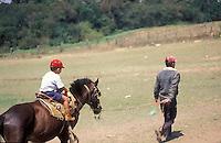 Niño montando a caballo, Lomas de Cubiro, Estado Lara, Venezuela.