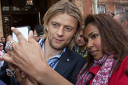 © licensed to London News Pictures. London, UK 26/05/2013. Anatoliy Tymoshchuk having a picture taken with a fan whilst FC Bayern Munich players leaving The Landmark Hotel in central London on Sunday, 26 May 2013 after their UEFA Champions League victory in Wembley Stadium against Borussia Dortmund. Photo credit: Tolga Akmen/LNP
