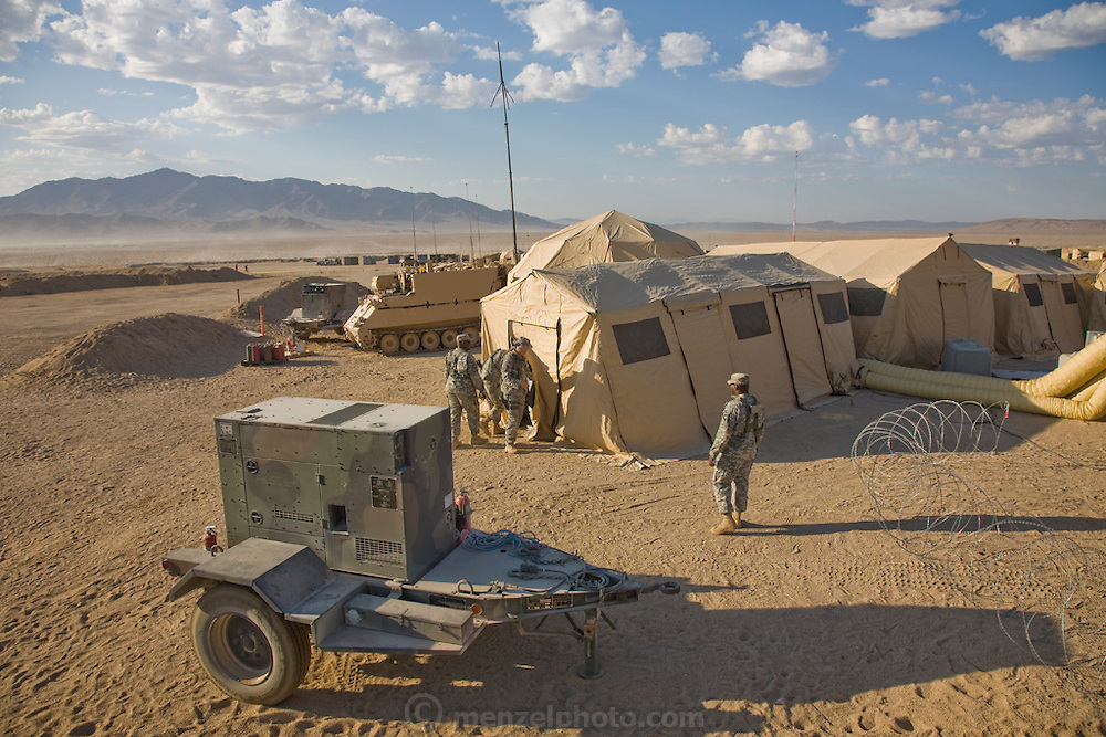 Military vehicles and tents used for training soldiers deploying to Iraq at Fort Irwin, California.