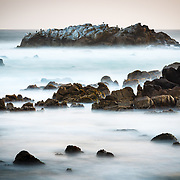 A long exposure of Spanish Bay on the Pacific Coast along 17 mile drive in Monterey.