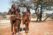 Himba women and children in Kaokoveld, the tribal village Namibia, Africa