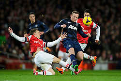 Man Utd Forward Wayne Rooney (ENG) is tackled by Arsenal Defender Laurent Koscielny (FRA) - Photo mandatory by-line: Rogan Thomson/JMP - 07966 386802 - 12/02/14 - SPORT - FOOTBALL - Emirates Stadium, London - Arsenal v Manchester United - Barclays Premier League.