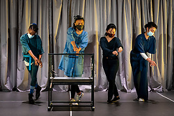 """© Licensed to London News Pictures. 11/05/2021. LONDON, UK. (L to R) Keziah Joseph, Janet Etuk, Tina Chiang and Etta Fusi perform at the preview at Shoreditch Town Hall of """"The Language of Kindness"""", a new work adapted and created by Sasha Milavic Davies and James Yeatman, based on Christie Watson's bestselling memoir of her twenty years as a nurse. The socially distanced, ensemble dance-theatre show celebrates nurses and front-line healthcare workers working for the NHS. It will premiere in Warwick in the first week that certain coronavirus lockdown restrictions are eased, before playing in Tunbridge Wells and London.  Photo credit: Stephen Chung/LNP"""