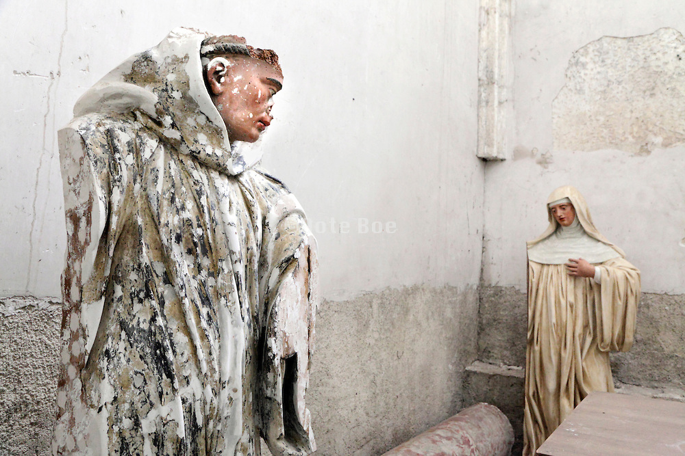 religious sculptures with a lot of damage in a side room in church