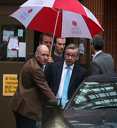 © Licensed to London News Pictures. 20/02/2016. London, UK. MICHAEL GOVE MP leaving a 'Vote Leave' meeting in Westminster underneath a Vote Leave umbrella after announcing he will vote against UK membership of the EU. . Photo credit: Ben Cawthra/LNP