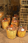 Small demi-johns for storing wines in wicker baskets  Domaine E Guigal, Ampuis, Cote Rotie, Rhone, France, Europe