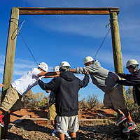 110813       Adron Gardner<br /> <br /> Wingate students use team work to balance on a diverging wire in Rehoboth Friday.