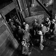 Miners entering the cage on surface for the beginning of day shift, Kerr Mine No. 3 Shaft, Virginiatown, Ontario. From the book Cage Call: Life and Death in the Hard Rock Mining Belt. An in-depth project spanning over 12-years examining communities in one of the richest mining regions in the world located in Northwestern Ontario and Northeastern Quebec in Canada.