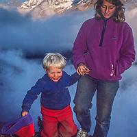 Meredith Wiltsie & 3-year old son Ben trek in the Khumbu Region of Nepal, with Mount Thamserku  in background.