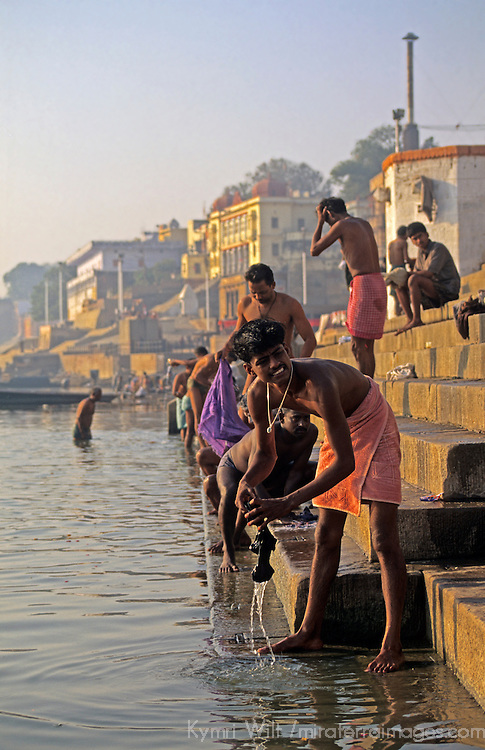 Asia, India, Varanasi. Men at Ganges river ghats of Varanasi.