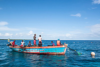 Illegal fishermen netting for fish in a protected area, Vamizi Island, Mozambique