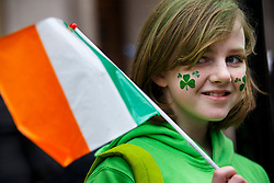 © Licensed to London News Pictures. 15/03/2015. LONDON, UK. People celebrating St Patrick's Day as a parade goes through the streets of central London on Sunday, 15 March 2015. Photo credit : Tolga Akmen/LNP