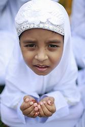 June 26, 2017 - Dhaka, Bangladesh - A Bangladeshi child offers her prayer as she attends in Eid ul-fitr prayer in Dhaka, Bangladesh. (Credit Image: © Suvra Kanti Das via ZUMA Wire)
