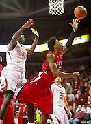 Nov 15, 2013; Fayetteville, Ar, USA; Louisiana-Lafayette Ragin' Cajuns guard Elfrid Payton (2) goes up for a layup past Arkansas Razorback forward Bobby Portis (10) during the second half of a game at Bud Walton Arena Arena. Arkansas defeated Louisiana-Lafayette 76-63.  Mandatory Credit: Beth Hall-USA TODAY Sports