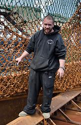 Fisherman Shows Off Scallop Nets, Kodiak Island, Alaska, US