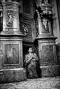 A pilgrim on her knees, Kalwaria Paclawska, Poland. The Assumption of the Virgin Mary into Heaven, informally known as The Assumption, according to the beliefs of the Roman Catholic Church, Eastern Orthodoxy, Oriental Orthodoxy, and parts of Anglicanism, was the bodily taking up of the Virgin Mary into Heaven at the end of her earthly life.