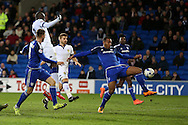 Kenneth Zohore of Cardiff city ® goes close to scoring with a shot at goal but sees it saved by Leeds goalkeeper Marco Silvestri. Skybet football league championship match, Cardiff city v Leeds Utd at the Cardiff city stadium in Cardiff, South Wales on Tuesday 8th March 2016.<br /> pic by  Andrew Orchard, Andrew Orchard sports photography.