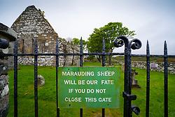 Sign on gate at Kildalton Old Parish Church , Kildalton, Islay, Scotland