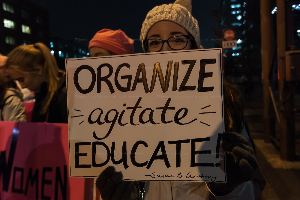 A woman holds a sign calling on Democrats to Organise, Agitate and Educate during a  protest march by members of the Democratic Party Abroad organisation to mark the inauguration of President Donald Trump, Tokyo, Japan. Friday January 20th 2017 Around 400 people took apart in the march, which started in Hibiya Park at 6:30pm and finished in Roppongi just before 8pm, to honour the service given by President Obama and to protest against the illiberal policies expected of the new administration of President  Trump.