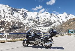 THEMENBILD - die Grossglockner Hochalpenstrasse. Die hochalpine Gebirgsstrasse verbindet die beiden oesterreichischen Bundeslaender Salzburg und Kaernten mit einer Laenge von 48 Kilometer. Sie ist als Erlebnisstrasse vorrangig von touristischer Bedeutung und das Befahren ist fuer Kraftfahrzeuge mautpflichtig, im Bild Motorrad vor dem Grossglockner Panorama, aufgenommen am 24.05.2014 // ILLUSTRATION - the Grossglockner High Alpine Road. The high alpine mountain road connects the two Austrian federal states of Salzburg and Carinthia with a length of 48 kilometers. It is as a matter of priority road experience of tourist importance and for driving motor vehicles is a toll road. Picture taken on 2014/05/24. EXPA Pictures © 2014, PhotoCredit: EXPA/ JFK