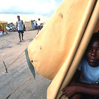 """Haitian refugees held at Guantanamo Bay Naval Station 9/27/94.Haitian refugees at Camp Buckley at the Guantanamo Bay Naval Station in Cuba 1991. Thousands of Haitian refugees heading to the US were stopped at sea and taken to GTMO as part of """"operation Safe Haven."""""""