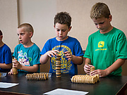 27 JUNE 2019 - CENTRAL CITY, IOWA: Participants stack sandwich cream cookies during the cookie stacking contest at the Linn County Fair. Summer is county fair season in Iowa. Most of Iowa's 99 counties host their county fairs before the Iowa State Fair, August 8-18 this year. The Linn County Fair runs June 26 - 30. The first county fair in Linn County was in 1855. The fair provides opportunities for 4-H members, FFA members and the youth of Linn County to showcase their accomplishments and talents and provide activities, entertainment and learning opportunities to the diverse citizens of Linn County and guests.        PHOTO BY JACK KURTZ
