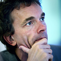 Nederland, Amsterdam , 2 november 2012.<br /> Rondetafelgesprek mediajournalisten in Lloyd Hotel.<br /> v.l.n.r. Jean Pierre Geelen (48)3,5 jaar recensent Volkskrant (op de foto)<br /> Hans Beerekamp (60) sinds 2003 NRC<br /> Mark Moorman (52) Al twintig jaar in Lips-carousel<br /> Willem Pekelder (53) Bijna 3 jaar Trouw<br /> Op de foto: Jean-Pierre Geelen<br /> <br /> Foto:Jean-Pierre Jans
