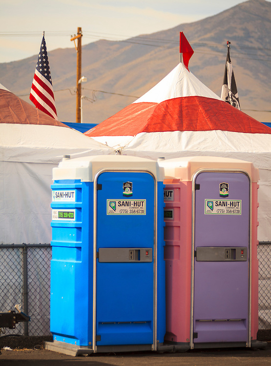 """The """"his 'n her"""" portable toilets at the 2012 Reno Air Races."""