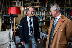 The Prince of Wales speaks with Falcon Scott, grandson of explorer Robert Falcon Scott, as they take a tour around his father Sir Peter Scott's house, during a visit to the Wildfowl and Wetlands Trust's Slimbridge Wetland Centre in Gloucestershire to celebrate its 70th anniversary.