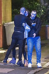 © Licensed to London News Pictures. 10/10/2020. Manchester, UK. A couple collide in to a third as they share a kiss . People out in pubs, bars and restaurants in Manchester City Centre ahead of the currently imposed daily 10pm curfew . Millions of people across the north of England are waiting to learn if the British Government will impose a regional lockdown on Monday (12th October 2020), as Coronovirus infection rates continue to rise rapidly . Photo credit: Joel Goodman/LNP