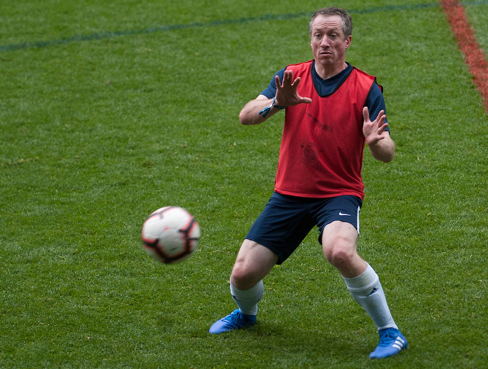 Clients take part in a football tournament at Stamford Bridge, the home of Chelsea Football Club. London, UK. May 17, 2019. <br /> <br /> Jack Megaw. All Rights Reserved.