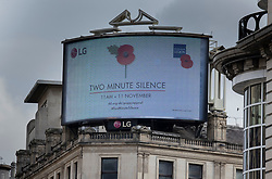 © Licensed to London News Pictures. 11/11/2020. London, UK. A giant TV screen announces the two minute silence  at Piccadilly Circus, central London at 11am in remembrance of the war dead. Scaled down Remembrance Sunday events were held because of the ongoing pandemic. Photo credit: Peter Macdiarmid/LNP