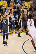 Golden State Warriors guard Stephen Curry (30) shoots a three pointer against the Houston Rockets during Game 4 of the Western Conference Finals at Oracle Arena in Oakland, Calif., on May 22, 2018. (Stan Olszewski/Special to S.F. Examiner)