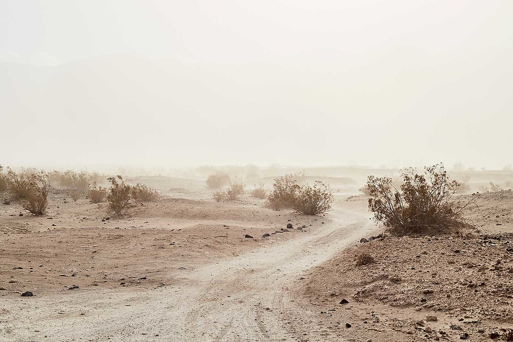 California lifestyle and adventure photographer Raymond Rudolph photographs a sand storm in Death Valley