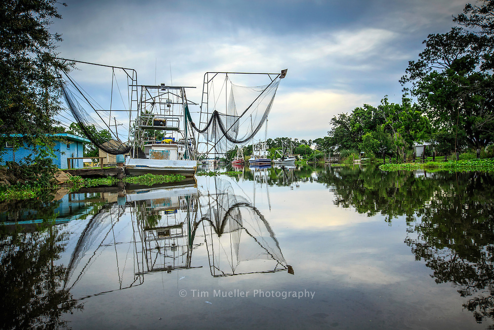 A shrimp boat with butterfly nets is docked along Bayou Petit Caillou near Chauvin in Terrebonne Parish, Louisiana.