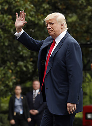 August 14, 2017 - Washington, District of Columbia, United States of America - United States President DONALD TRUMP waves to the media as he arrives on the South Lawn for a day of meetings at the White House, in Washington, DC.  (Credit Image: © Martin H. Simon/CNP via ZUMA Wire)