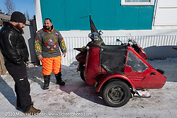 Moscow motorcycle mechanic Alexander Pikalo upon arriving after a 10,000 km ride from Moscow on his Honda Silver Wing scooter for the Baikal Mile Ice Speed Festival. Maksimiha, Siberia, Russia. Tuesday, February 25, 2020. Photography ©2020 Michael Lichter.