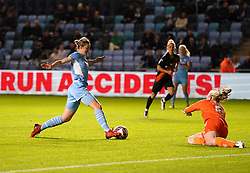 Manchester City's Ellen White (left) attempts to get past Everton goalkeeper Courtney Brosnan during the FA Women's League Cup Group B match at the Manchester City Academy Stadium. Picture date: Wednesday October 13, 2021.
