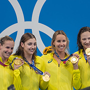 TOKYO, JAPAN - JULY 25: The Australian team of Bronte Campbell, Cate Campbell, Meg Harris and Emma Mckeon with their gold medals after their world record performance in the 4 x 100m Freestyle Relay for women during the Swimming Finals at the Tokyo Aquatic Centre at the Tokyo 2020 Summer Olympic Games on July 25, 2021 in Tokyo, Japan. (Photo by Tim Clayton/Corbis via Getty Images)